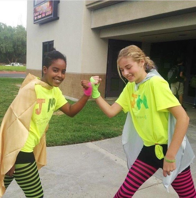 This photo of 13-year-old Jewish and Muslim best friends dressing as new superhero team, The Juslims, for Halloween.